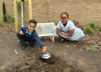 Pupils mark official opening of school by burying time capsule