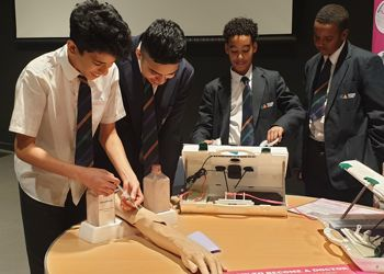 Students perfect their bedside manner at medical careers roadshow